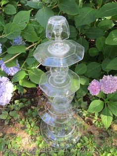 repurposed glassware used in the garden and in the home for catch-alls.  So easy to make, and sturdier than you think.
