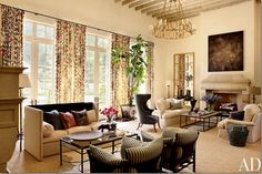 oh to have two fireplaces in the living room!  love the geometric mirrors and the furniture arrangement