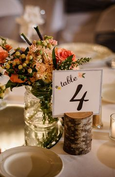Cute rustic table number + floral centerpiece pairing /// Photo by Gray Photography via Project Wedding