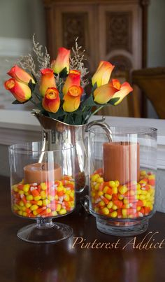Halloween decor doesn't need to be spooky! Adding flowers and bright colored candy can add a nice touch to any room!