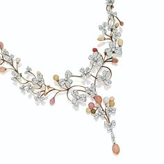 DIAMOND AND CONCH PEARL NECKLACE The graduating collar with central fringe composed of diamond-set three-leaf clovers on a meandering vine, further decorated with conch pearl buds in pale to deep pink and bronze hue, set with numerous old European-cut diamonds weighing approximately 11.30 carats, mounted in gold and platinum, length approximately 16 inches.
