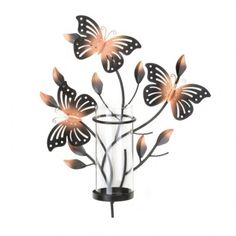 Three beautiful butterflies are awaiting candlelight to help them shine brightly! This charming wall sconce features a tall, clear glass candle cup and platform ready for the candle of your choice. Wall Candle Holders, Candle Wall Sconces, Glass Candle Holders, Home Wall Art, Wall Art Decor, Metal Butterfly Wall Art, Butterfly Design, Mason Jars, Modern Sconces