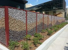 ECO-ROCK™ Wall Systems - University of Chicago Child Care Center uses ECO-ROCK™ Wall System to create a wire mesh fence filled with colorful rocks.
