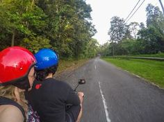 The two of us driving around Langkawi island on a moped, Malaysia.