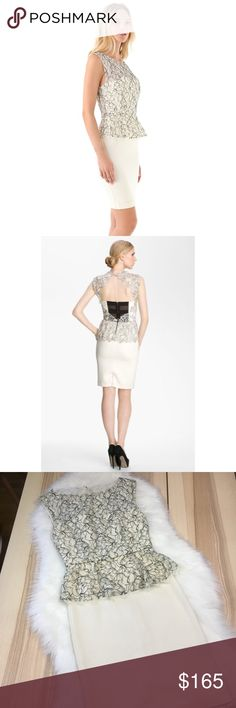 alice + olivia Shovan Peplum Dress with Open Back An overlay of embroidered lace conceals the corseted bodice of this alice + olivia dress, ending in a flirty peplum edged in eyelash trim. The skirt is sleek and fitted, and detailed with a back slit. A cutout offers a peek at the back, and closes with a pearlescent button and an exposed zip. Stretch silk  Very lightly worn, slight mark on the skirt (didn't notice it until under the photography lights) See photos for measurements. No trades…