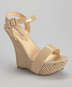 Beige Hara Wedge Sandal by Bucco 27.99  Sure to elevate an everyday ensemble, the Hara boasts a patterned wedge and sleek straps. An adjustable buckle closure ensures an optimal fit, while an open construction showcases pretty pedicures