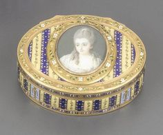 A GOLD AND ENAMEL PORTRAIT SNUFF BOX, MAKER'S MARK VPF IN A HEART INCUSE, BETWEEN TWO CROWNED LETTERS J, PROBABLY GENEVA, CIRCA 1785<br><br>DETAILED DESCRIPTION<br>oval, the lid inset with a miniature, French School, circa 1775, taken after a portrait, of the princesse d'Hénin, née Mauconseil, with powdered hair, wearing a white dress, the box decorated in a silk pattern of dark blue and yellow stripes embellished with coloured <EM>paillons</EM>, within chased and enamelled garland borders…
