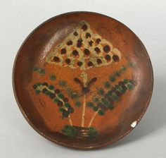 """Realized Price: $ 2106  North Carolina or Pennsylvania redware pie plate, 19th c., with yellow, green, and brown slip dot and circle flower decoration on an orange glazed ground, 8 1/4"""" dia. For a similar example, see the John Gordon Collection, Christie's, January 1999, lots 300-303; and Bivins, The Moravian Potters in North Carolina, plate 253. Pook & Pook ...~♥~"""