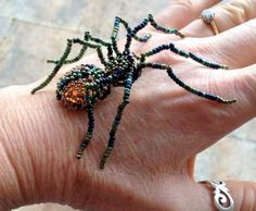 My beaded spider friend. I love the way the light shows as an amber glow in the abdomen cabochon - (smoke topaz).