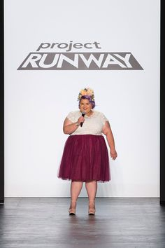 Project Runway Season 14 Winner, Ashley Nell Tipton, matches her collection with a floral headpiece at the finale.
