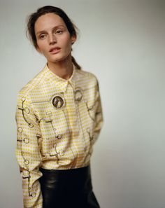 Hermès - Vestiaire d'Hiver 2015. THE PRINTED SHIRT in bright yellow silk twill, panelled skirt in black grained goatskin #hermes