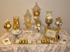 gold candy buffet | personalized chocolates and golden treats adorned the candy table