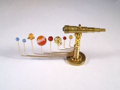 Miniature moveable medieval orrery and telescope