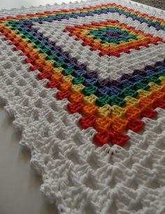Rainbow Crochet Baby Blanket // Granny Square by TheUnknotting