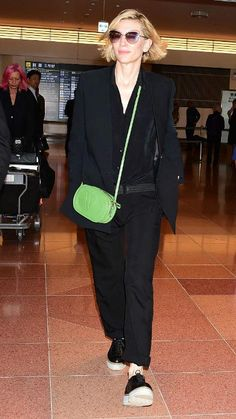 Cate Blanchett is well known for her quirky and unique style and it has helped her win huge fan following. On April 21, 2016, as she stepped out of the Haneda Airport in Ōta, Tokyo, she was certainly dressed to impress in her characteristic androgynous look. The famous Australian actress opted to go for all black ensemble with button down shirt, blazer and tailored trousers as she touched down in Japan for the promotion of her movie – Carol.
