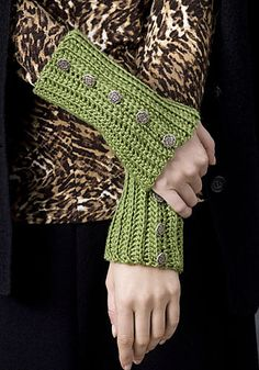 One skein wristlets - easy rows of single crochet in the back loop. These wrist warmers are all about the buttons.