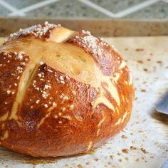 Pretzel Bread with Active Dry Yeast, Warm Water, Milk, Dark Brown Sugar, Melted Butter, Coarse Salt, Bread Flour, Water, Baking Soda, Coarse Salt, Melted Butter.