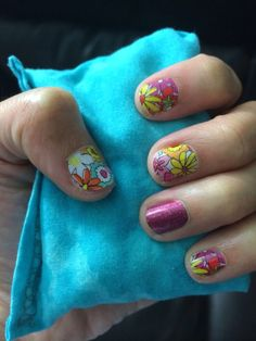 Daisy Doodle with Fizzy Grape Sparkle Jamberry Nail Wraps!  Get yours today at www.brittny.jamberrynails.net Or host a Facebook party and get them free! Ask me how!