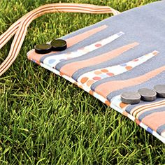 A portable backgammon board perfect for summertime road trips, camping, or backyard fun.