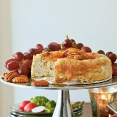 Roquefort Cheesecake with Pear Preserves and Pecans is ideal for large gatherings--it makes 12 appetizer servings. Pear preserves balance the tanginess of the Roquefort cheese, and toasted pecans add nutty flavor to this herb-and-pecan cheese spread.