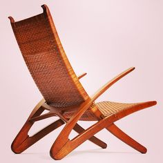 HANS J. WEGNER, Dolphin chair, model JH510.  Designed in 1950. Foldable armchair with oak frame, woven cane seat and back, brass mounts. Pro...