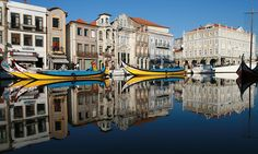"""Aveiro is often compared with Amsterdam or Venice, despite having only three canals, but the many medieval features it has managed to preserve do make it very attractive. This is due in no small measure to the barcos moliceiros and a canal trip on one of these boats shows Aveiro at its most appealing"" Text & Photo Source: http://www.enjoyourholiday.com/2011/01/11/aveiro-the-place-to-go/"