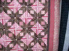 pink/brown log cabin
