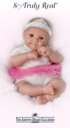 A So Truly Real® baby doll by artist Cheryl Hill with RealTouch® vinyl skin, baby-fine hair, poseable arms and legs, and a head that turns.