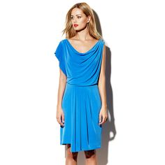 Going to St. Barth's, I'd absolutely need to have a cute dress for dancing or going to a club. The SLIT BACK DRAPED DRESS BLUE not only fits the bill, but it's the perfect color to wear near the bright blue ocean.