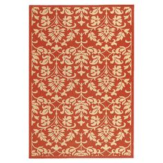 Anchor your sunroom or patio seating arrangement in chic style with this elegant indoor/outdoor rug, showcasing a floral motif in red.
