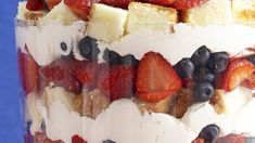 A big berry trifle, built with pound cake cubes, gets its red, white, and blue colors from a lot of white-chocolate flavored whipped cream, strawberries and blueberries.