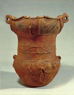 Deep clay pot. The retainer of the pot has a human motif.   BC.3,500 - BC.2,500. Jomon era. Yamanashi Japan.