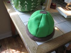How to make a cactus hat: Tutorial – Jumbo Jibbles Cactus Hat, Hat Tutorial, Bean Bag Chair, Projects, How To Make, Cactus, Carnival, Log Projects, Bean Bag Chairs