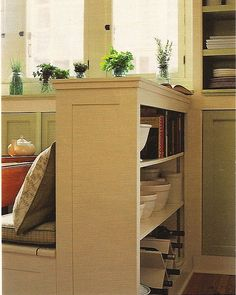 bookcase behind banquette in kitchen | Great storage solution for all my cookbooks, clean eating & bon appetit cooking magazines nestled in their ikea magazine holders.
