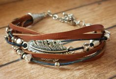 Feather, Brown Leather Bracelet, Antiqued Silver Feather, Multi-Layer Leather Strands, Connector, Free, Spirit, Blue and Brown, Cuff, Stack by RemindMeDesigns on Etsy https://www.etsy.com/listing/278875618/feather-brown-leather-bracelet-antiqued