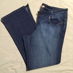 """Paris Blues Flared Leg Jeans Flared Leg Jeans • Double Button & Zip Closure • Scoop Pockets & Coin Pocket In Front • Patch Pockets In Back With Mint Green Stitching • Super Comfy With Some Stretch • 98% Cotton, 2% Spandex • 32"""" Inseam • 4"""" Slit On The Sides • Excellent Condition Paris Blues Jeans Flare & Wide Leg"""