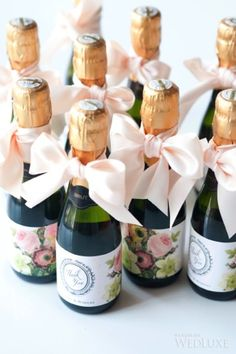 How cute are these custom designed champagne bottles?