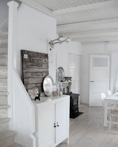 The white..the weathered wood..the black stove and those lovely stairs