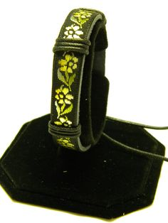 Leather Wristband with Yellow Flowers by CreationsbyDreamLady