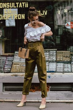 Mango khaki high waisted trousers, topshop high waist trousers, khaki pants for women, stradivarius frilled white shoulder top, zara beige suede heeled mules, asos bamboo basket bag, nanna cay bags, wicker bag, straw bags for summer, square straw bag, cutest bag for summer, the best bag for summer, woven mini bag, raffia bag, the bag you have seen everywhere on Instagram, ray ban aviator clear lens glasses, silver hoop earrings, jewelry, ruffle blouse, gingham print, bun, top knot, messy…