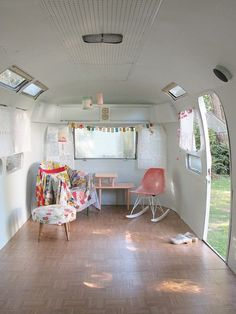 what a great recycle of an old camper! every kid should have a playhouse like this