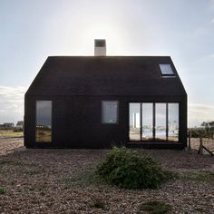 Home exterior contemporary design facade Little tiny black house architecture .