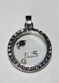 CLASS OF 2015 & Graduation Cap Floating Charm + Pearl 3 Living Locket Charms USA #Classof2015 #Graduation 3 charms for any floating/living/memory locket such as Origami Owl or Lauren Nicole lockets like the one pictured above. Included is a silver 2015 charm, a graduation cap charm, and a pearl to perfectly accent the other 2 charms.