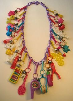 1980's Plastic Charm Necklace. I had a couple of plastic charm necklaces like this in the 80's and LOVED them. My favorite was the working abacus, because all of the little pieces actually moved. AWESOME.