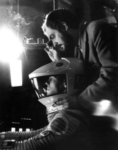 "Stanley Kubrick smoking and looking through his viewfinder on the set of ""2001 A Space Odyssey"""