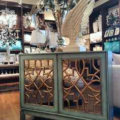 New for Fall/Winter 2014: our new Marie Cabinet is a favorite with pinners, and now you can find it in our stores! Aquamarine outer and inner surfaces are balanced with antique gold filigree and mirrored door panels. Two doors swing wide for easy access to the adjustable shelves inside. Perfect for a living room or entryway.