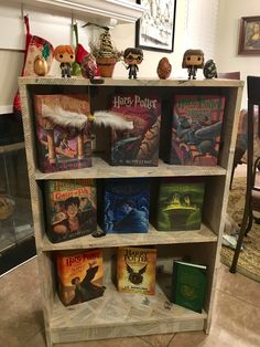 Mod Podged IKEA Avdala bookcase using pages from recycled paperbacks from the Harry Potter series.