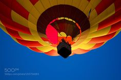 hot air balloon in a blue sky by arthurmoutardier