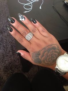 Black stiletto nails, ring finger sparkle black with 3D bows
