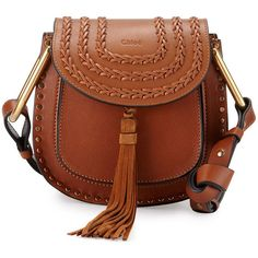 This Saddle bag from Tula has a turn lock front made of old ...